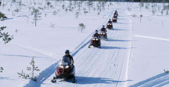 Snowmobile Safari in the snowy wilderness
