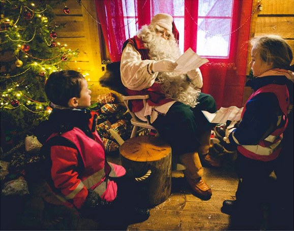 Santa Claus in Lapland reading wish lists