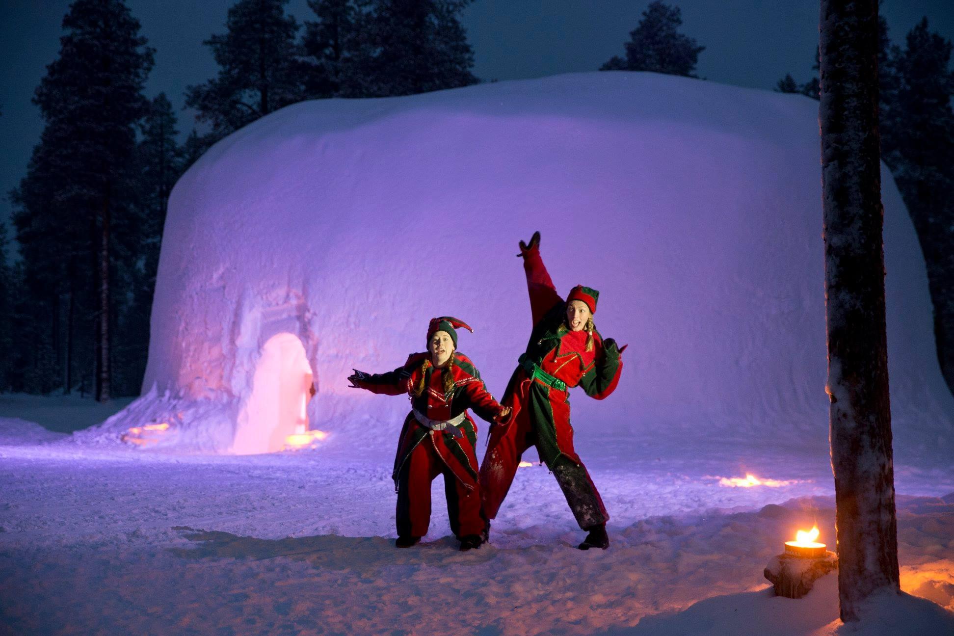 santa's elves outside a santa's lapland igloo